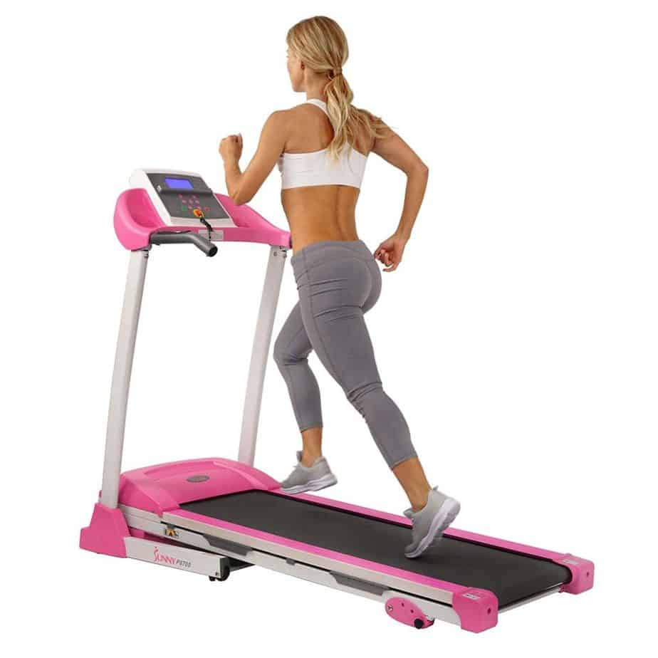 A lady is running on the Sunny Health & Fitness P8700 Treadmill